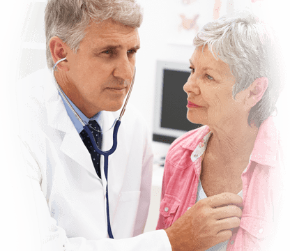 physician listens to the heartbeat of an older female patient