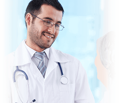 male doctor smiles while listening to patient