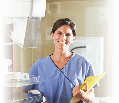 Smiling nurse holding paperwork