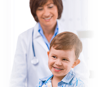 Smiling child with female pediatrician