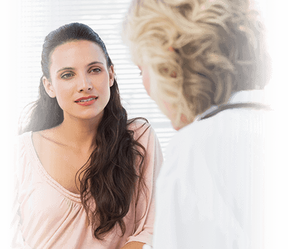 Woman intently listening to her doctor