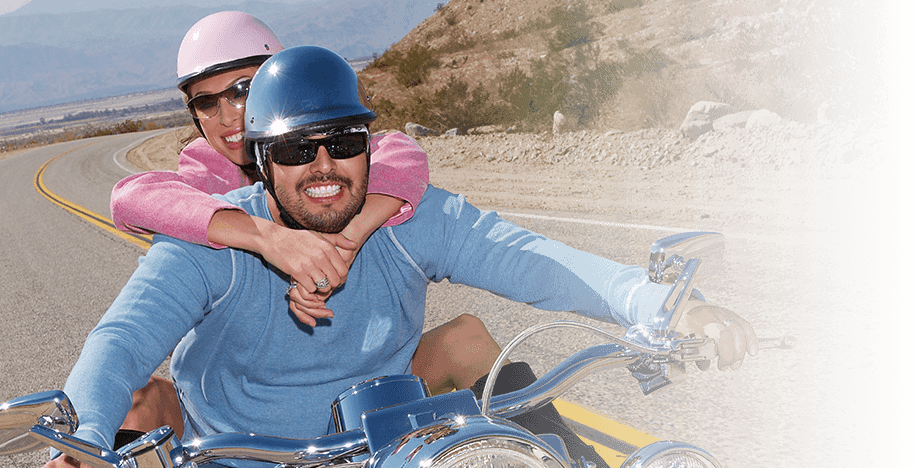 Couple enjoying motorcycle ride